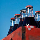 a six pack of bottled soda
